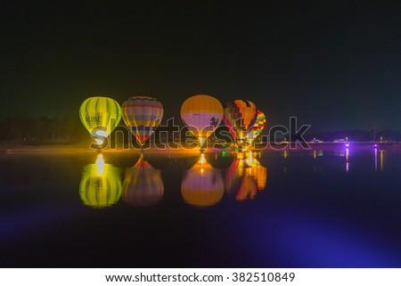 CHIANG RAI , THAILAND - FEBRUARY 14, 2016 : Hot air balloon show at night in Thailand International Balloon Festival 2016 in SINGHA Park of Thailand ,CHIANG RAI Thailand. - stock photo