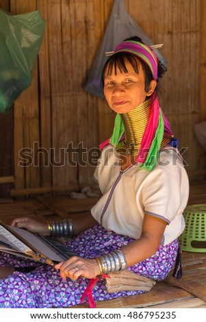 CHIANG RAI / THAILAND - FEBRUARY 10 2016: Visit ethnic village, near the town of Chiang Rai where the locals live by historical laws, wearing national clothes and engaged in their craft.