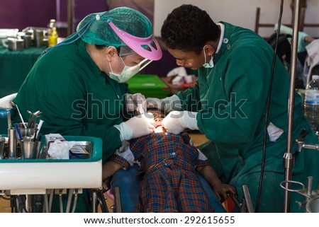 CHIANG RAI, THAILAND -MARCH 29 2015: Unidentified dentist volunteer from public hospital are in medical services at Ban Huai Ya Sai school on March 29,2015 in Chiang rai,Thailand. - stock photo