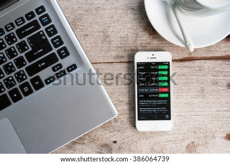 CHIANG RAI,THAILAND - MARCH 03,2016: Yahoo Finance app showing on iPhone 5. Overview of stock market data from the US and major global indices featuring interesting moving stocks - stock photo