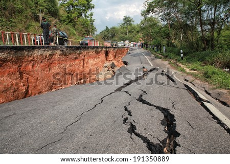 CHIANG RAI, THAILAND-MAY 5:Cracked asphalt after earthquake, soldier Check locations on May 5,2014 in Chiang Rai, Thailand. - stock photo
