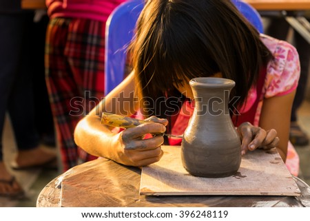 Chiang Rai, THAILAND - NOVEMBER 29 : Children are making pottery before go to oven at Doi Tung on November 29, 2015 in Chiang Rai, Thailand. - stock photo