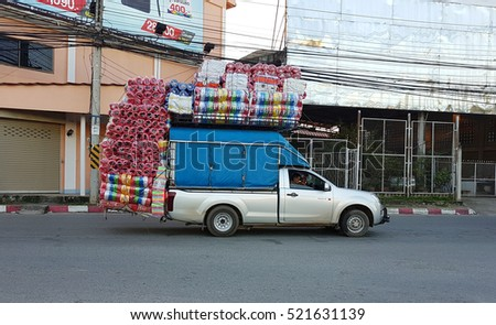 CHIANG RAI, THAILAND - NOVEMBER 22 : pick-up truck carrying plastic ropes on the road on November 22, 2016 in Chiang rai, Thailand