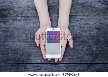 CHIANG RAI, THAILAND - SEPTEMBER 13, 2015: Woman try to log in page Instagram application using Apple iPhone 6. Instagram is largest and most popular photograph social networking site in the world.