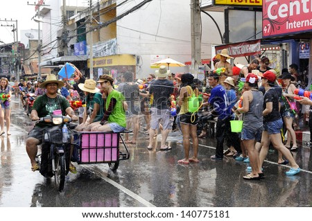 CHIANGMAI THAILAND-APRIL 13:Chiangmai Songkran festival.Tourists came out to splatter some fun to this Songkran festival at Tha Pae gate.on April 13,2013 in Chiangmai,Thailand.