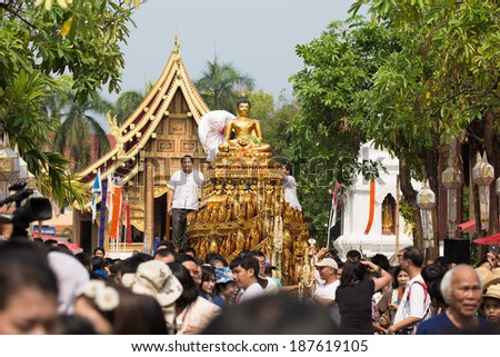 CHIANGMAI, THAILAND - APRIL 13: Phra Singh statue of Phra Singh temple was moved to the parade cars for pour water in Songkran festival 2014 on April 13, 2014 in Chiang Mai, Thailand.