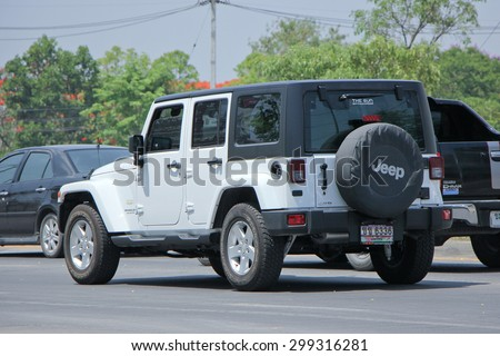 CHIANGMAI , THAILAND -APRIL 30 2015: Private jeep car, Wrangler Unlimited Sahara. Photo at road no.121 about 8 km from downtown Chiangmai, thailand. - stock photo