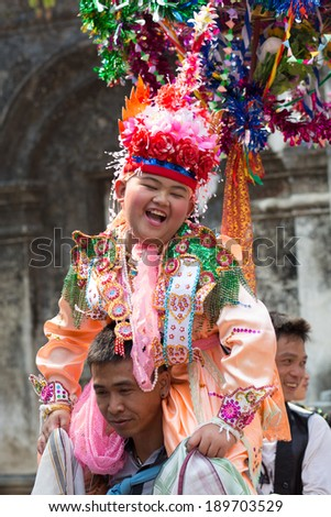 CHIANGMAI, THAILAND - APRIL 6: Unidentified child and people in Poy Sang Long festival on April 6, 2014 in Chiang Mai, Thailand.