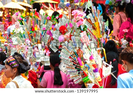CHIANGMAI,THAILAND-APRIL 5 : Unidentified peoples hold offering given as alms in Poy-Sang-Long festival,during in parades around township to Wat Pa Pao on April 5,2013 in Chiangmai city, Thailand.