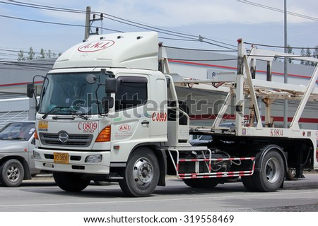 CHIANGMAI, THAILAND -AUGUST 20 2015: ANI Logistics Group carrier trailer Truck for Honda car. Photo at Road No.1001 about 8 Km from Chiangmai city.