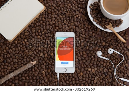 CHIANGMAI, THAILAND -August 3, 2015:iPhone opened to google plus homepage. Googleplus, share and discover everything on Googleplus. - stock photo