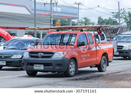 CHIANGMAI, THAILAND -AUGUST 8 2015:  Pickup truck of Tot company.Intenet and Telephone Service in Thailand. Photo at road no.121 about 8 km from downtown Chiangmai, thailand. - stock photo
