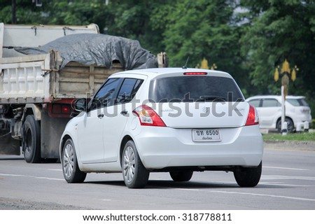 CHIANGMAI, THAILAND -AUGUST 20 2015: Private car, Suzuki swift. Photo at road no 121 about 8 km from downtown Chiangmai, thailand.