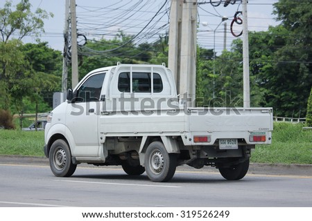 CHIANGMAI, THAILAND -AUGUST 20 2015: Private Pick up Truck, Suzuki Carry. Photo at road no 121 about 8 km from downtown Chiangmai, thailand.