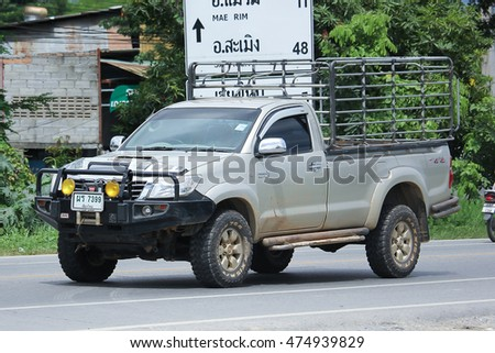 CHIANGMAI, THAILAND -AUGUST 9 2016:  Private Pickup car, Toyota Hilux. Top Sale Pickup in thailand.  On road no.1001, 8 km from Chiangmai Business Area.