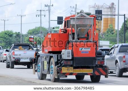 CHIANGMAI, THAILAND -AUGUST 8 2015:  TADANO Crane Truck of Naphasin Company. Photo at road no 121 about 8 km from downtown Chiangmai, thailand. - stock photo