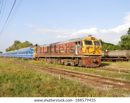 CHIANGMAI , THAILAND -DECEMBER 6 2006: Ge Diesel locomotive no.4530 and train no 14 from chiangmai to bangkok. Photo at Chiangmai railway station.