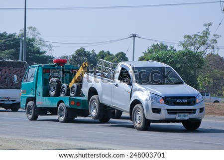 CHIANGMAI , THAILAND - DECEMBER 20 2014: SayThong Tow truck for emergency car move. Photo at road no 1001 about 8 km from downtown Chiangmai, thailand. - stock photo