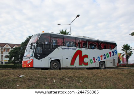CHIANGMAI, THAILAND - DECEMBER  3 2014: School bus of Cherdchai transport company. Photo at road no.121 about 8 km from downtown Chiangmai, thailand. - stock photo