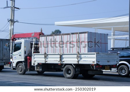 CHIANGMAI , THAILAND - DECEMBER 23 2014:  Truck with Crane Satapornnirattisai  transport Company. Photo at road no 1001 about 8 km from downtown Chiangmai, thailand.