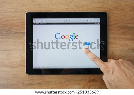 Chiangmai,Thailand - February 9, 2015: A Google search home page on a ipad screen, new app for mobile devices - stock photo