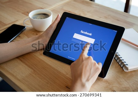 CHIANGMAI,THAILAND - FEBRUARY 19, 2015: Facebook is an online social networking service founded in February 2004 by Mark Zuckerberg with his college roommates and is now a fortune 500 company. - stock photo