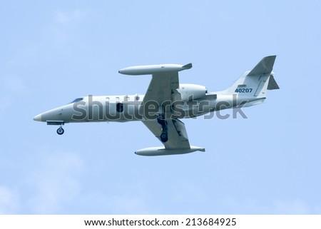 CHIANGMAI , THAILAND - FEBRUARY 13 2008: 40207 Lear Jet 35A of Royal Thai Air force. Landing to Chiangmai Airport. - stock photo