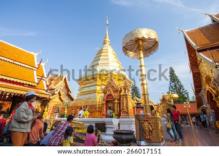 CHIANGMAI, THAILAND, FEBRUARY 9, 2013: Locals and tourists come to pray at the Doi Suthep Temple in Chiang Mai. The temple founded in 1385 is a major tourist attraction in Chiang Mai. - stock photo