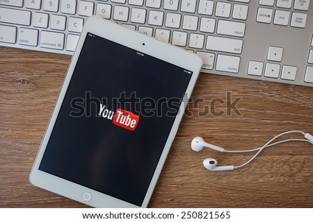 CHIANGMAI,THAILAND - FEBRUARY 8, 2015. New Apple iPad mini in gray space black color with YouTube screen on Macbook keyboard. - stock photo