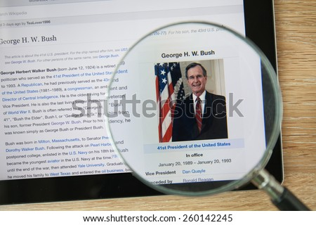 CHIANGMAI, THAILAND - February 26, 2015: Photo of Wikipedia article page about George Herbert Walker Bush on a ipad monitor screen through a magnifying glass. - stock photo
