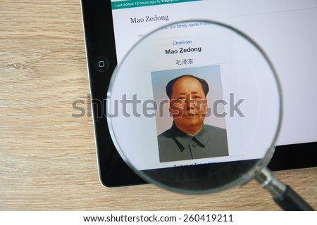 CHIANGMAI, THAILAND - February 26, 2015: Photo of Wikipedia article page about Mao Zedong on a ipad monitor screen through a magnifying glass. - stock photo