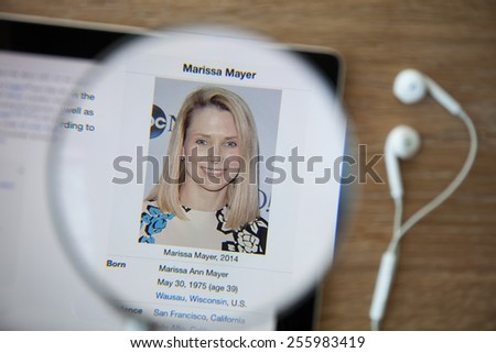 CHIANGMAI, THAILAND - February 26, 2015: Photo of Wikipedia article page about Marissa Mayer on a ipad monitor screen through a magnifying glass. - stock photo