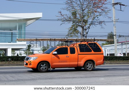 CHIANGMAI , THAILAND- FEBRUARY 5 2015: Pickup truck of CAT Telecom Public Company Limited. Intenet and Telephone Service in Thailand. Photo at road no 121 about 8 km from downtown Chiangmai, thailand. - stock photo