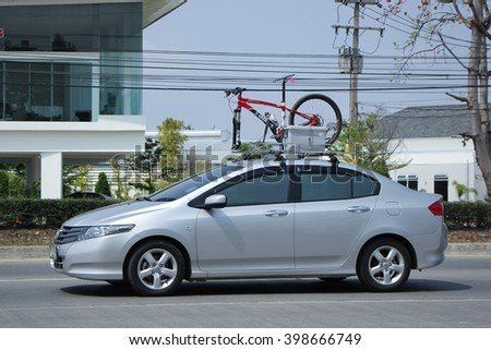 CHIANGMAI, THAILAND -FEBRUARY 27 2016:  Private City Car, Honda City with bicycle. On road no.1001, 8 km from Chiangmai city.