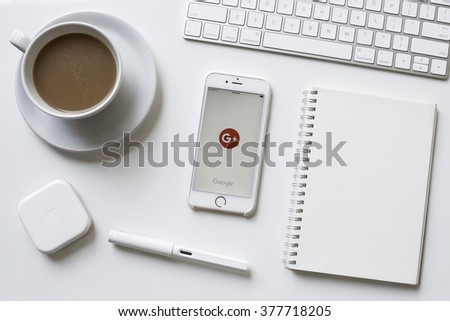 CHIANGMAI, THAILAND - FEBRUARY 13, 2016: Screen of Apple iPhone 6s showing Google Plus app on office desk with supply. Google Plus is social network service operaed by Google Inc. - stock photo
