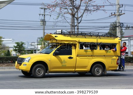 CHIANGMAI, THAILAND -FEBRUARY 27 2016:  Yellow mini truck taxi chiangmai, Service between city and Maejam Subdistrict. Photo at road no 121 about 8 km from downtown Chiangmai, thailand.