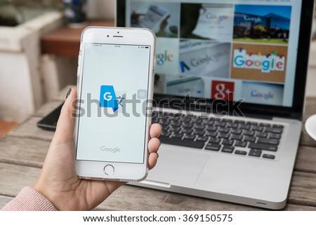 CHIANGMAI,THAILAND - JAN 19 ,2016: Woman holding iPhone 6 plus with Google Translate app. - stock photo