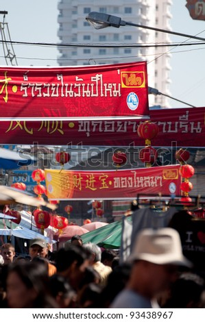 CHIANGMAI THAILAND-JANUARY 23 :Chinese New Year in Thailand. People come to watch the opening ceremony and visit to the Chinese market Warorot. on January 23,2012 in Chiangmai,Thailand.