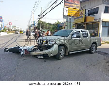 CHIANGMAI, THAILAND - JANUARY 10, 2013: Crash Accident NISSAN FRONTIER NAVARA Pickup Truck with HONDA Motorcycle at roadside in Chiangmai, Northern Thailand. - stock photo
