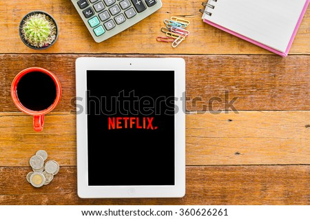 CHIANGMAI, THAILAND -JANUARY 10,2016:IPad 4 open Netflix application. Netflix is an American provider of on-demand Internet streaming media available founded in 1997 by Marc Randolph and Reed Hastings - stock photo