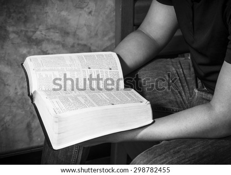 CHIANGMAI, THAILAND - July 22, 2015. A man hands holding  the open  bible (New International  Version) christian believe that  the bible is the word of God and  try to reading the bible everyday. - stock photo