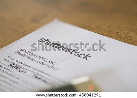 CHIANGMAI, THAILAND - JULY 25,2016: A paper of model release shutterstock,Shutterstock is a popular sell picture in website.