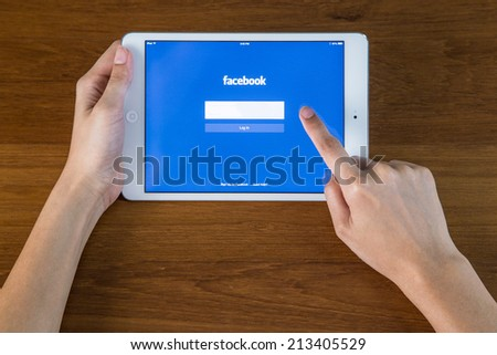 CHIANGMAI, THAILAND - JULY 26, 2014: Facebook is an online social networking service founded in February 2004 by Mark Zuckerberg with his college roommates and is now a fortune 500 company. - stock photo