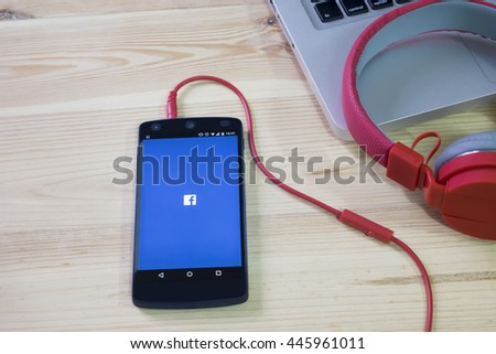 CHIANGMAI, THAILAND -JULY 1, 2016:Facebook page on the smartphone on table. Facebook is very well know social networking service founded in 2004 by Mark Zuckerberg - stock photo