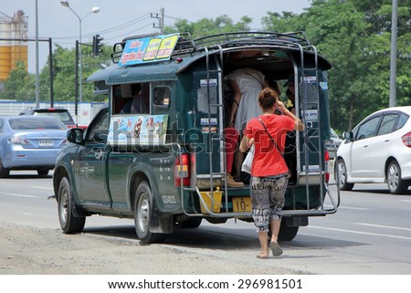 CHIANGMAI , THAILAND -JULY  4 2015 :  Passenger of Green mini truck taxi chiangmai, Service between city and Sansai district. Photo at road no.1001 about 8 km from downtown Chiangmai, thailand.