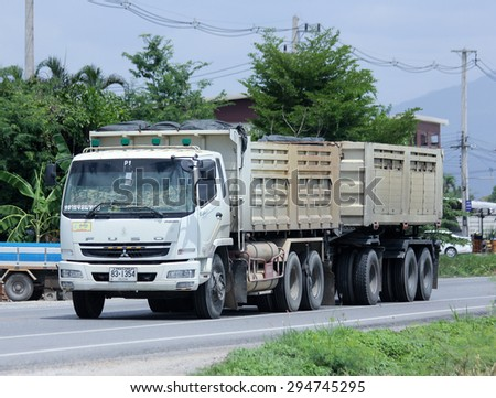 CHIANGMAI, THAILAND -JULY 2 2015: Trailer Dump truck of Sayjomthong Company. Photo at road no.121 about 8 km from downtown Chiangmai, thailand.