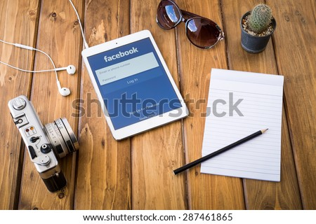CHIANGMAI, THAILAND -JUNE 14, 2015:Facebook is an online social networking service founded in February 2004 by Mark Zuckerberg with his college roommates and is now a fortune 500 company. - stock photo