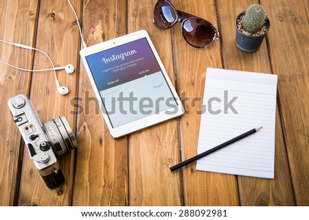 CHIANGMAI, THAILAND -JUNE 14, 2015:Instagram page on new ipad mini. The photo-sharing social network, which has 150 million monthly active users - stock photo