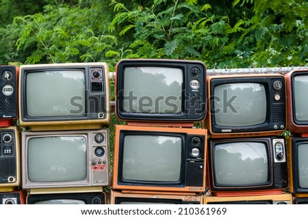 Chiangmai, Thailand-June 11, 2014: Many Old televisions in unidentified garden place set for decorate place on June 11, 2014, Chiangmai, Thailand.