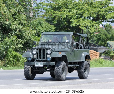 CHIANGMAI, THAILAND - JUNE 4 2015:  : Old Jeep Private car. Photo at road no 121 about 8 km from downtown Chiangmai, thailand. - stock photo